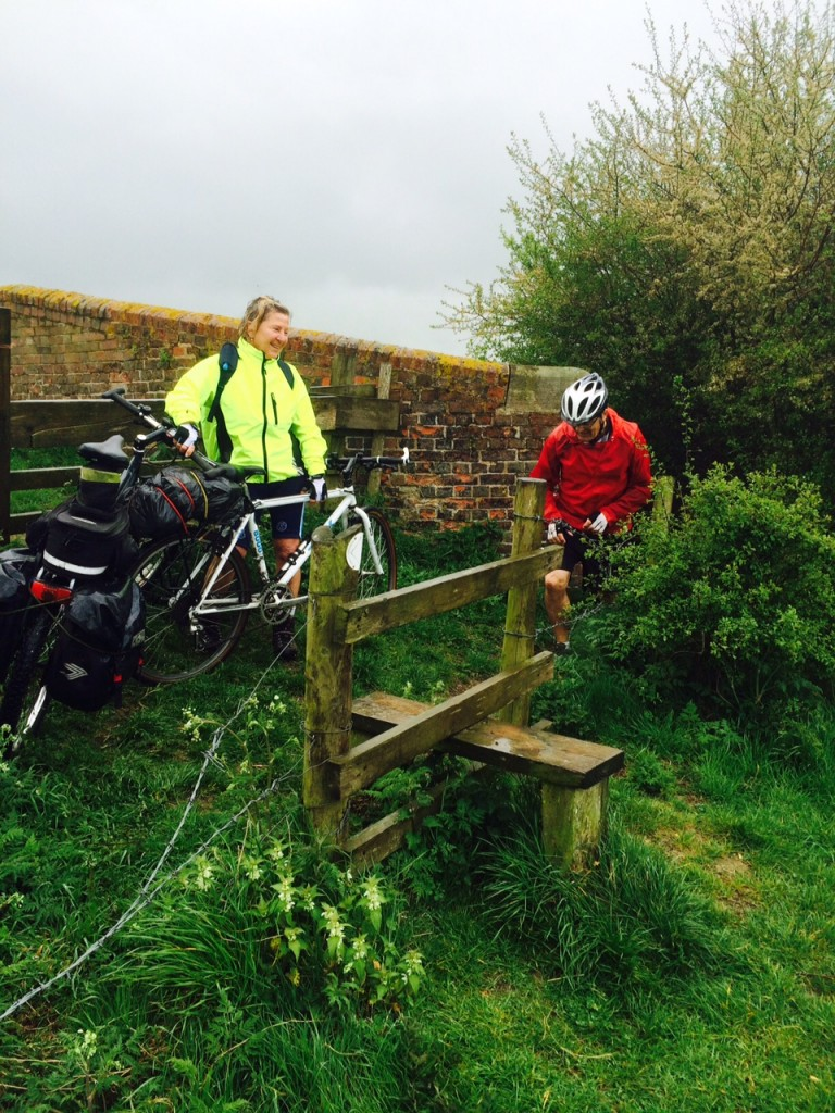 Susan holding the bikes while Paul takes them down to the canal side